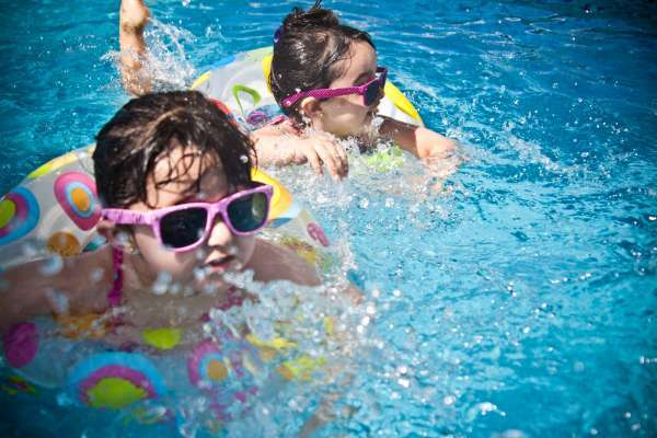 girls wearing sunglasses swimming pool swimming